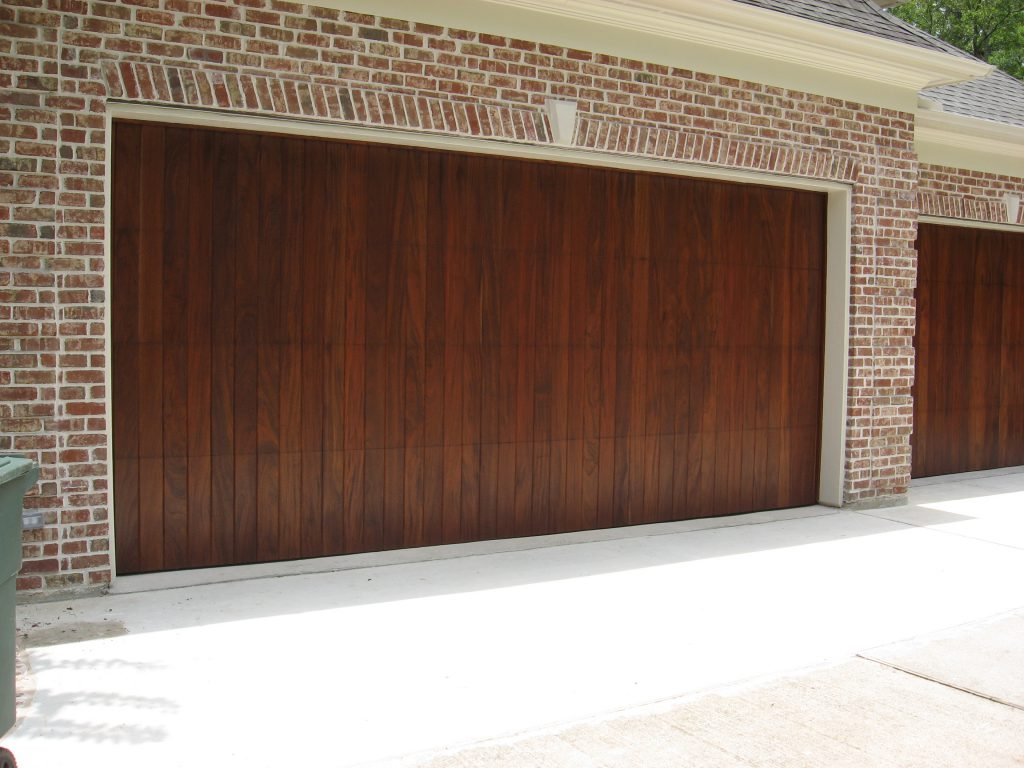 Custom wood doors overhead door company of conroe every custom wood door is exactly that custom choose your wood your finish your accessories to create a door that enhances the look and appeal of your rubansaba